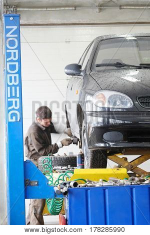 Kaluga, Russia - March, 24, 2017: Worker in a car repair station in Kaluga