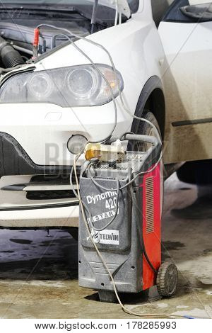 Kaluga, Russia - March, 24, 2017: welder near the car in a body shop of car repair station in Kaluga