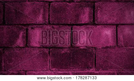 Abstract image of a brick wall the color of Beaujolais. Grunge brick wall. Brick, brick texture, brick background.