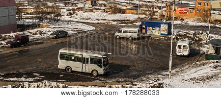 Kazakhstan, Ust-Kamenogorsk, march 12, 2017: Top view of the final bus stop, minibuses, urban outskirts