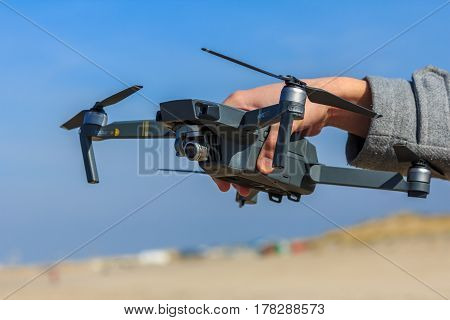 Kijkduin the Netherlands - March 24 2017: man holding quadcopter drone