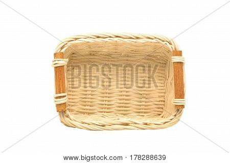 Empty wicker basket wooden fruit or bread basket on white background in top view