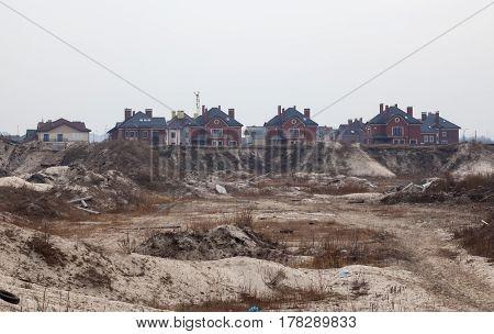 New luxury houses near the abandoned city landfill in Kyiv Ukraine.
