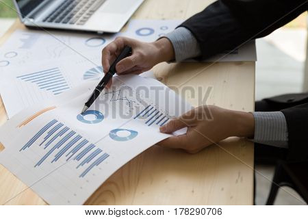 Businessman Analyzing Charts And Graphs With Modern Laptop Computer.