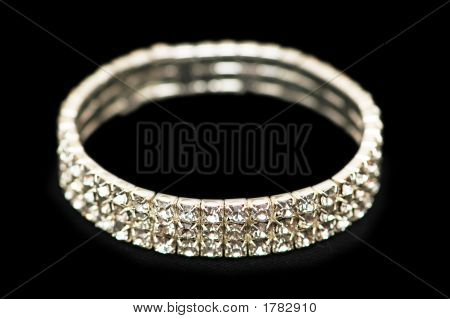 Bracelet With Diamonds Isolated  On The Black