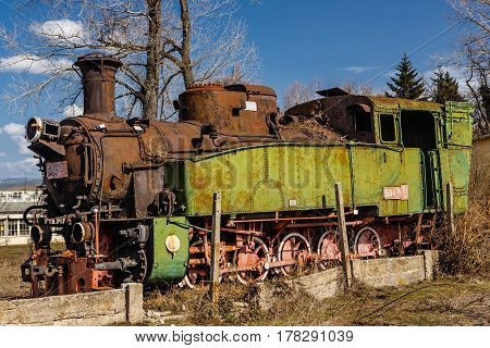 Abandoned rusty steam engine in the deadlock at the provincial railway station