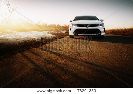 Saratov, Russia - March 15, 2017: White Car Toyota Camry Xv50 At Empty Countryside Asphalt Road At S