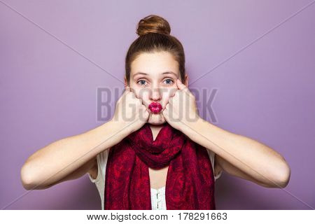 Idea, portrait happy beautiful woman thinking looking up pointing with finger at blank copy space on purple background. Positive human face expressions, emotions, feelings body language.
