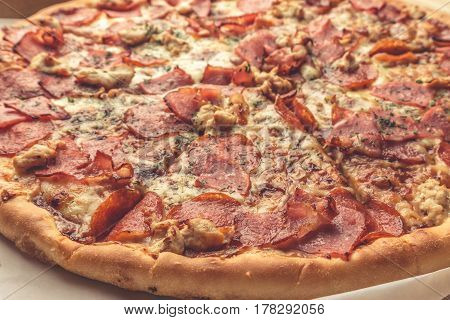 Pizza close up photo, meat ingredients: ham, bacon, chicken breast, delicious homemade pastries concept
