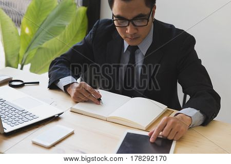 Businessman Watching Something On Digital Tablet In Office