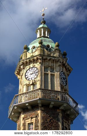 Victorian hospital clock tower with copper roof