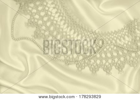 Smooth Elegant Golden Silk Or Satin With Pearls And Lace As Wedding Background. In Sepia Toned. Retr