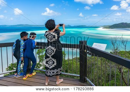Woman Taking Picture Of Beautiful Tropical Lagoon With Her Smartphone