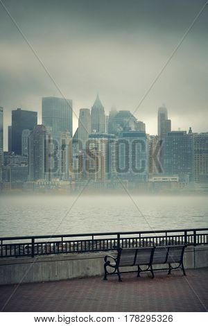 New York City downtown business district in a foggy day viewed from park
