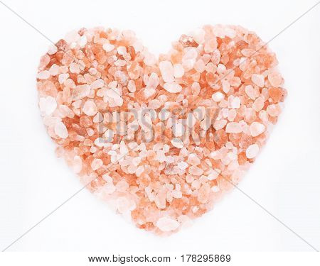 Pink himalayan salt heart isolated on white background