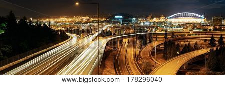 Seattle at night with traffic light trails and highway