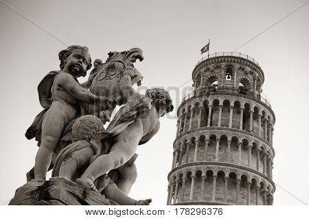 Leaning tower and fountain sculpture in Pisa, Italy as the worldwide known landmark.