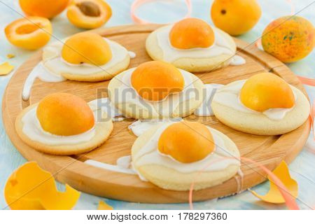 Easter egg cookies - shortbread cookies with glaze and apricots shaped fried eggs funny idea for sweet Easter treats for kids