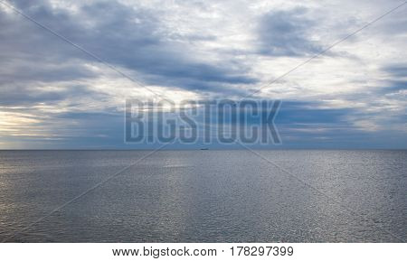 Ship lying at anchor in the roads in the Black Sea. Distant view.