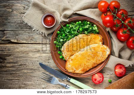 German-style chicken schnitzel with fresh vegetable top view