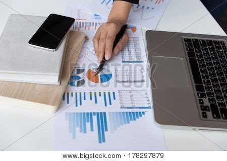 Business Woman Analyzing Income Charts And Graphs With Modern Laptop Computer. Business Analysis And