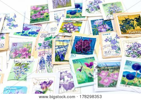 A Stamp Printed In Japan Shows Violet Flower Collection.