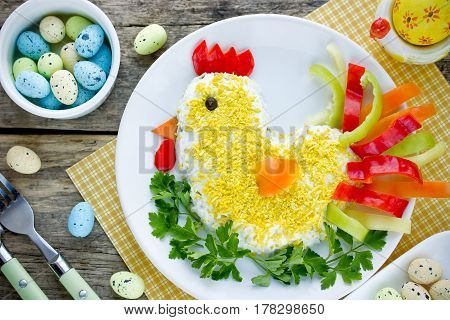 Easter snack idea - layered vegetable egg salad in shape Easter chicken