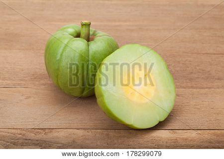 fresh Green Garcinia Cambogia on wood background