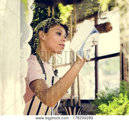 African Descent Woman Cleaning Wiping Shop Glass
