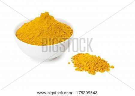Turmeric Powder In White Ceramic Bowl