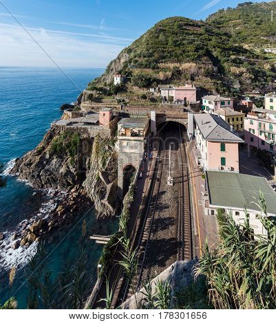 Small train station on the rocks of Riomaggiore town, Italy