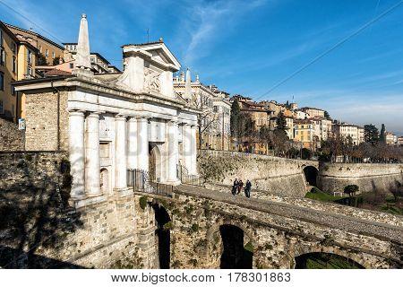 BERGAMO, ITALY - DECEMBER 2016: People on bridge of  San Marco city gate in Bergamo town, Italy.