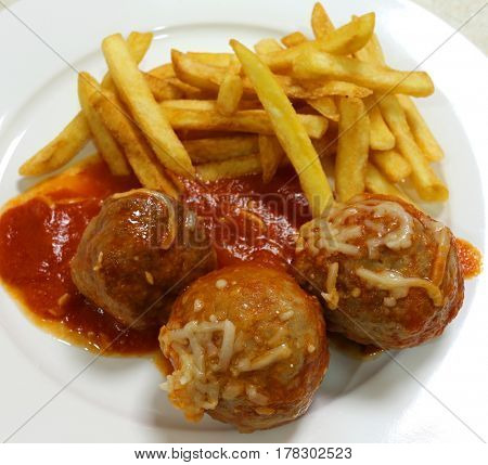 Meatballs and fries high angle
