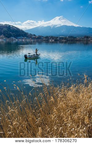 Fisherman in the Kawaguchiko Lake with Fuji mountain Tokyo Japan