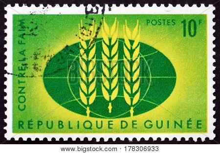 GUINEA - CIRCA 1963: a stamp printed in Guinea shows Wheat Emblem and Globe Freedom from Hunger Campaign circa 1963