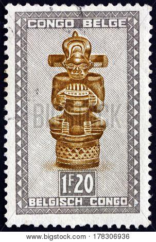 BELGIAN CONGO - CIRCA 1950: a stamp printed in Belgian Congo shows Tsimanyi an Idol Carved Figure of Baluba tribe circa 1950