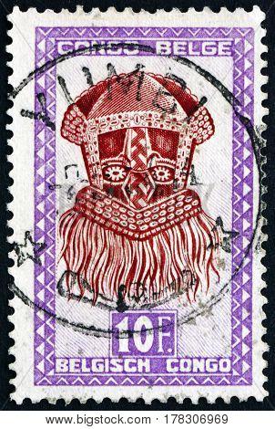 BELGIAN CONGO - CIRCA 1948: a stamp printed in Belgian Congo shows Buadi-Muadi mask with Squared Features Baluba tribe circa 1948