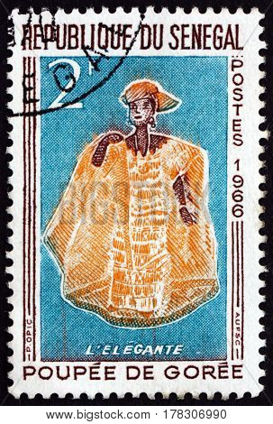 SENEGAL - CIRCA 1966: a stamp printed in Senegal shows Elegant Woman Doll of Goree circa 1966