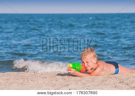 Little Boy Play With Water Gun 5