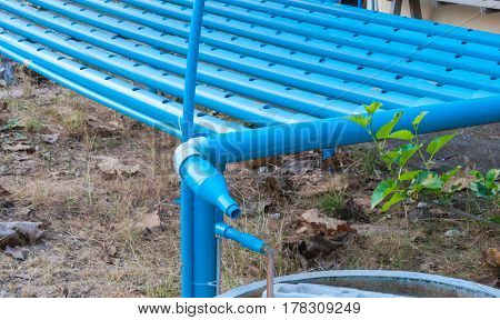 Closeup To Blue Pipes In Hydroponics Planting System