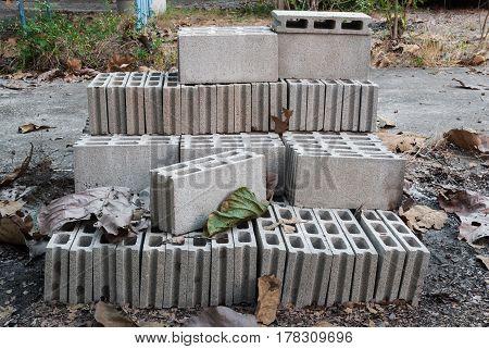 Pile Of Unused Concrete Brick On Ground
