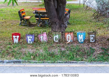 Colorful Welcome Alphabet Letter Pot In Park