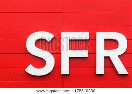 Orleans, France - March 19 2017: SFR logo on a wall. SFR is a French telecommunications company that provides voice, video, data, and Internet telecommunications and professional services to consumers
