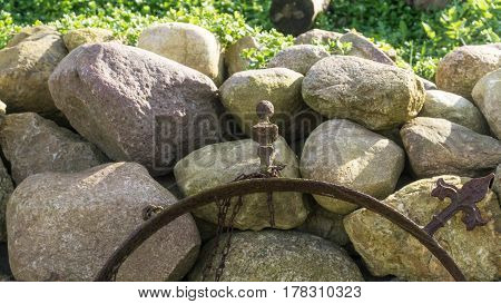 Field stone wall in the garden at sunshine