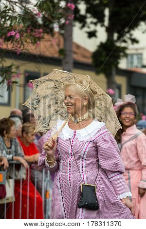FUNCHAL MADEIRA PORTUGAL - SEPTEMBER 4 2016: Women in historical fashion dress durnig historical and ethnographic parade of Madeira Wine Festival in Funchal. Madeira Portugal