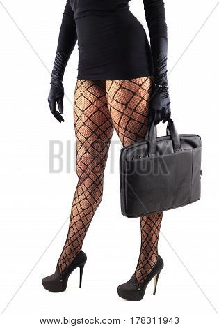 Sexy female legs in beautiful stylish stockings and high heels shoes black gloves and dress holding business bag isolated on white background