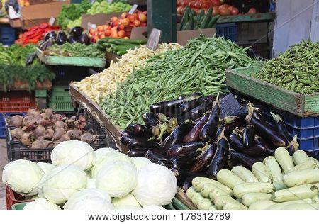 Fresh organic vegetables pile on market stall