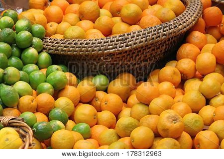 Fresh organic citrus fruits pile on market stall