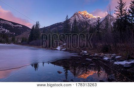 Mount Lorette Ponds in Kananaskis Country at sunrise.
