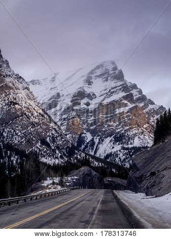 Highway through Kananaskis Country. Mount Kidd is visible in the background.